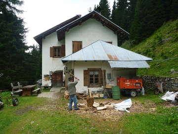 Preparing wood for cooking dinner at Malga Antola